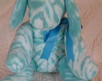 Plush blue and white dog.  Huggable!