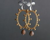 gold dangle earrings with natural seeds and silver ear wires