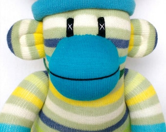 Green and and multicoloured Striped Sock Monkey with removable  blue pom pom hat