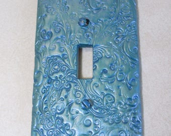 Blue flash curly swirly single light switch cover