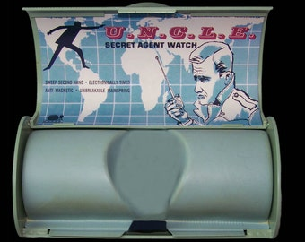 1964 Bradley Man From U.N.C.L.E. UNCLE WATCH CASE complete with reproduction insert card and side decal