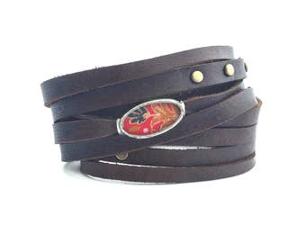 Shi Bandit Cuff: Leather Wrap Cuff with Brass Studs and Silk Charm