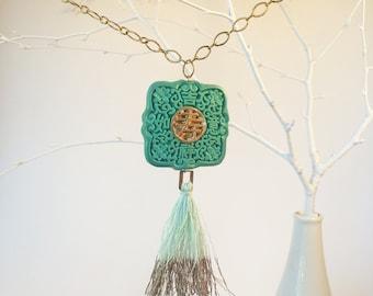 metallic mint green tassle with oriental Asian green cinnabar pendant on brass plated gold-tone chain