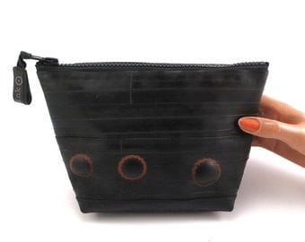 Recycled bicycle inner tube cosmetic pouch for men and woman, container, bag, with black zipper and 3 patches.