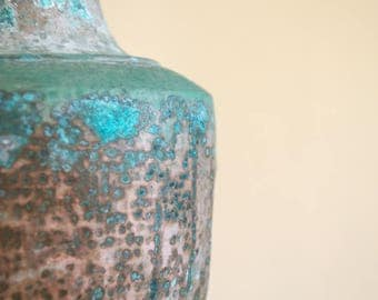 Patina - Copper patina lamp or vase blue green brown against beige Still life Art Photograph taken in Pahoa Hawaii by Sarah McTernen