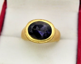AAA Iolite Violet Blue   11x9mm  2.51 Carats   in Ladies 18K Yellow gold cocktail ring 10 grams. 2630