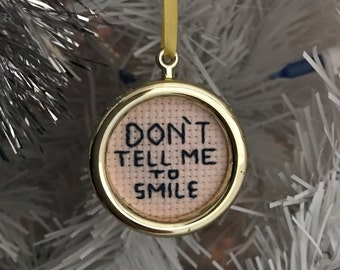 Don't tell me to smile feminist Christmas ornament