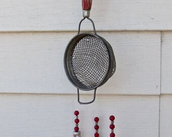"WIND CHIME REcycled from an antiQue wire STRAINER And antiQue measuring spoons- + Red,Silver beads and 5 ""tin can beads from Scotland"""
