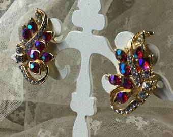 Brilliant Swirling Rhinestone and Goldtone Earrings AB Fuchsia and Clear Rhinestones Clip On Unsigned