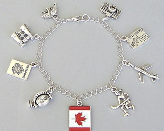 Canada charm bracelet or Canada necklace, Canadian flag, maple leaf, passport, bear, hockey player, North America travel charm bracelet