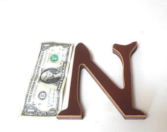 Large Wooden Letter Capitol N Red With Off White Outline Distressed 5.5 inches Tall X 5 Inches Wide At Widest