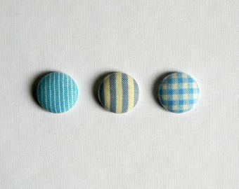 Lapel pin. Mens lapel button. Round boutonniere. Light blue. Geometric buttonhole. Pinstripe. Stripes. Gingham.