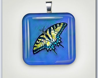 Butterfly with Blue Background Glass Pendant