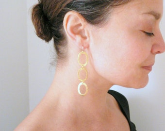 Gold shoulder dusters Articulated gold hoops Hammered brass long dangles Long gold earrings Gold drop earrings Articulated hoops