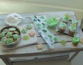 Dollhouse miniatures baking St. Patrick's day cookies and cupcakes