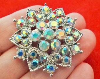"""Vintage 1.5"""" art deco silver tone brooch with aurora borealis rhinestones in great condition, appears unworn"""