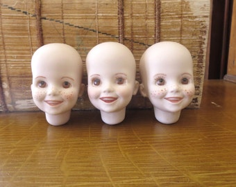 3 Vintage doll heads Ceramic doll heads Porcelain doll heads Bisque doll heads Doll parts Reproduction doll head 1980's Cheap Inexpensive