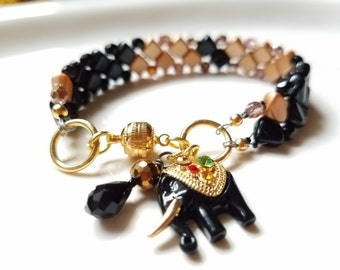 gold and black beadwork bracelet, boho beadwoven bracelet, unique bead cuff bracelet, elephant charm bracelet, gift for the elephant lover