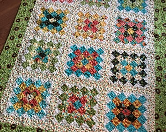 Quilt -- Baby Girl or Lap -- Frolic and Sassy fabrics -- granny square -- blue, yellow, green, cream, pink