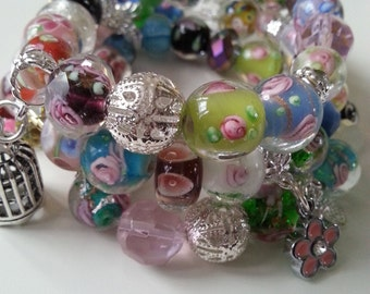 3, triple, Spring, Charm bracelets,  Lamp work Glass, pastels, butterfly, flower, mix colour, soft colors, by NewellsJewels on etsy