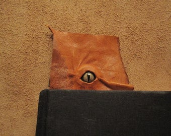 Grichels leather bookmark - distressed rusty brown with green speckled slit pupil reptile eye