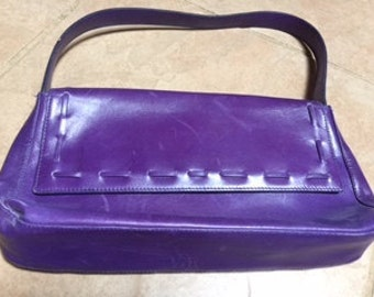 Purple leather handbag with flap