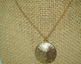 1970s  Golden Dipped Real Sand Dollar Necklace.
