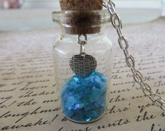 Glass Jar Pendant Necklace With Chunky Blue Heart Glitter And A Silver Heart Charm