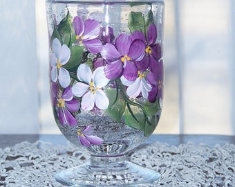Glass candle holder with magenta pink wildflowers