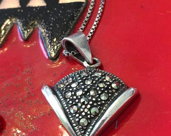 Sterling Silver marcasite Pendant on a sterling box chain .