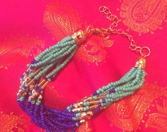 Beaded bracelet blue multi color twist seed beads goldtone clasp