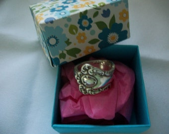 A beautiful ring handcrafted from antique silverware and a free handmade gift box