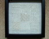 Pulled fabric work sampler framed.