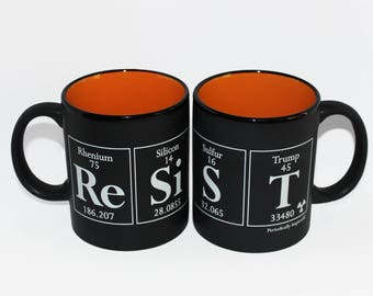 RESIST Coffee Cup - Matte Black Ceramic Mug with CHEETO ORANGE Interior - Periodic Table & Trump-inspired Coffee Cup, 11 oz.