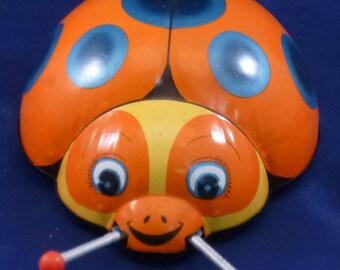 Vintage Nomura TN Jitter Bug Wind Up Tin Toy, 1950s