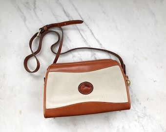 Dooney and Bourke white and tan crossbody