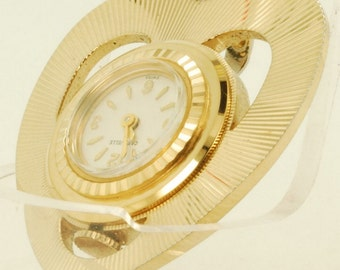 Caravelle vintage pendant watch, 7 Jewels, gold-toned heart-shaped pendant supporting round watch in center