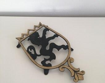 Mid Century Lion Trivet Royal Crest Goldtone and Black Nordia
