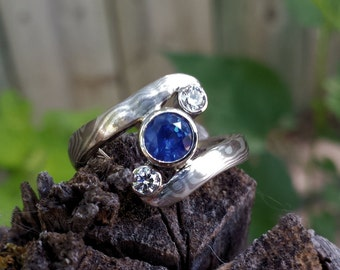 Three stone Mokume Gane engagment ring with Blue Sapphire and diamonds