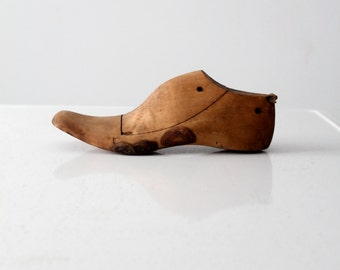 antique cobbler's last, wood shoe form with leather patches, wooden foot last