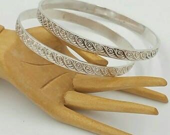 Vintage Sterling Bangles Pair Of Matching Etched Design.