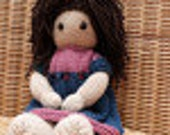 Hand knitted brown-haired doll