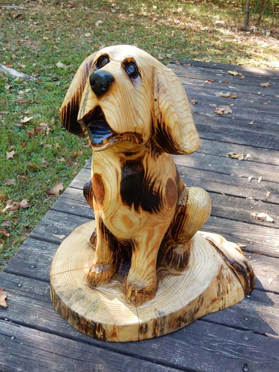 Chainsaw carving sitting dog