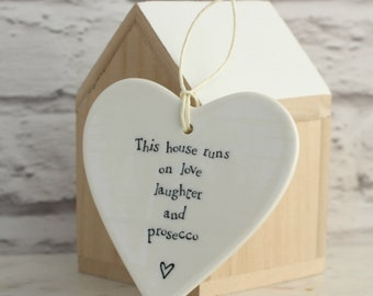 Love Laughter And Prosecco Hanging Ceramic Heart