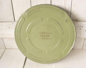 Vintage film canister painted green metal Eastman Kodak industrial decor