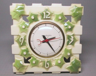 Harker pottery ? Mastercrafters clock , pottery with ivy decoration ( not Mccoy pottery , doh ) kitchen wall