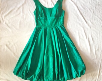 Orginal 1950s bubble hem dress . Sharkskin iridescent Green bombshell retro pin up