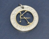 Ka. Stephen King Dark tower necklace pendant cut coin charm. Circulated dualtone bimetallic Egypt pound coin jewelry