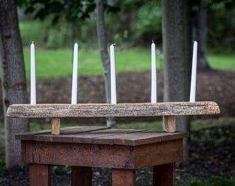 Reclaimed wood candlestick holder.