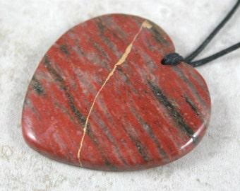 Kintsugi (kintsukuroi) red jasper stone heart pendant with gold repair on black cotton cord - OOAK